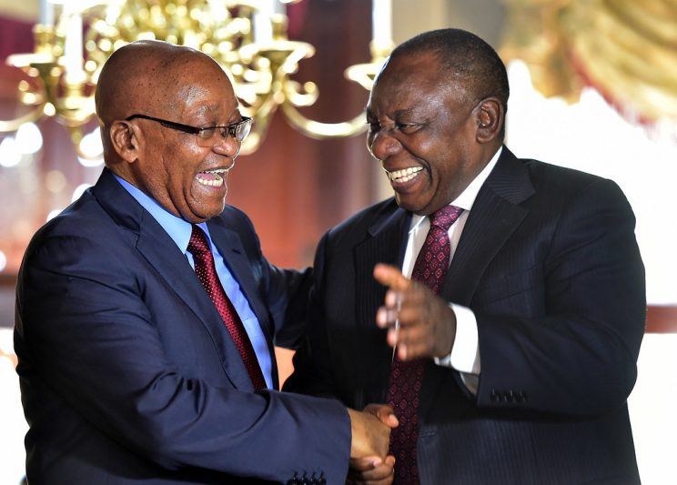 Two politicians in suits shaking hands