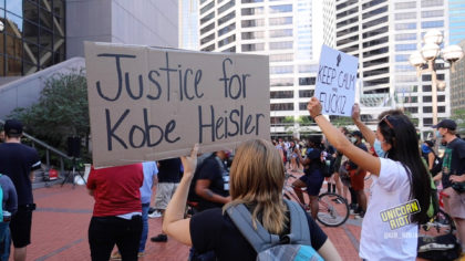 Justice for Kobe Heisler sign held up during demo