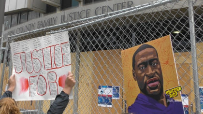 Poster of George Floyd held outside of courthouse